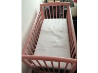 Pink mini cot