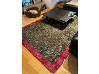 Beautiful designers guild rug and possibly cushions