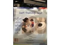 Child's toilet training seat, brand new in box.