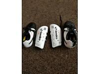 Footy trainers plus shin pads