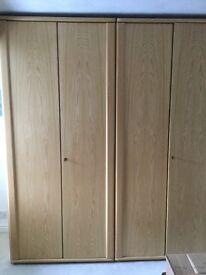 Light oak five door floor to ceiling wardrobes