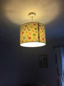 Multi coloured star curtains and lamp shades