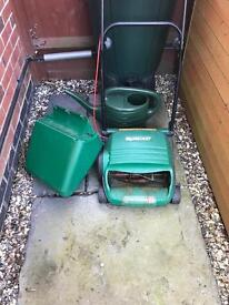 Qualcast mower with roller and grass bin