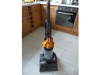 Dyson Dc27 multi floor vacuum cleaner with all crevice tools.