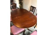 Expanding Dinning room table and 6 chairs