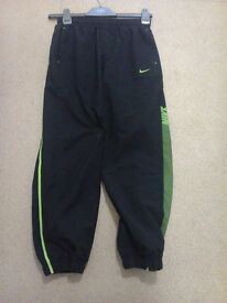 Nike black with green stripe jog pants elastic bottoms size 10/12 yrs