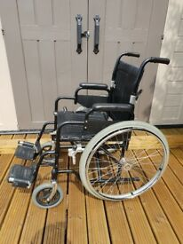 Enigma self propelling fold up wheelchair