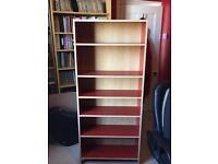Red upright standalone bookshelves