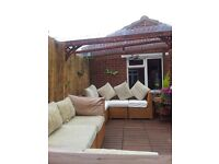 TWO RATTAN CORNER SETS COST 2500 CAN DELIVER