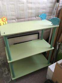 Children's book / toy shelves elephants and lion