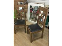 Two John Lewis solid wood chairs