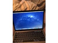 late 2016 space grey macbook pro 13inch with touch bar