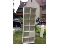 Tall white shelving unit available today