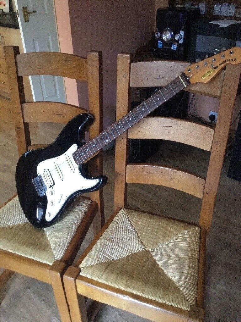 Fender Stratocaster black electric guitar Sunn Mustang