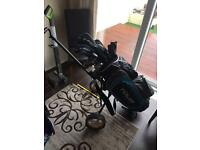 Full set of Dunlop right-handed golf clubs in a bag, including trolley