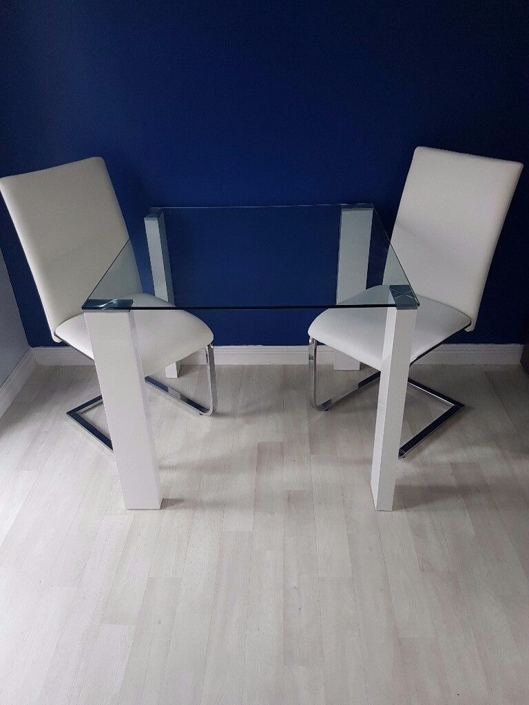 Modern glass dining table with 2 white chairs