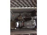 Canon XF105 high def broadcast camcorder - digital camera not dslr