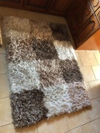 Gorgeous brown and cream rug, practically new