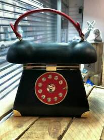 For sale new ladies telephone handbag with mirror some scrapes on mirror