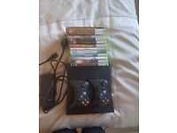 Xbox 360, Two controllers and 11 Games. Good Condition