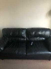 2 x 2 black leather sofa's. WILL DELIVER