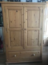 Pine Wooden Wardrobe with bottom drawer. length 106cm, height 157, width 54cm. Good condition.