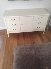 White/cream sideboard with 6 drawers and middle storage area.