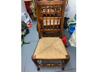 6 dark wood spindle back rush seat dining chairs.
