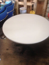 Grey Round Wood Effect Table in Used Condition