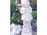 Garden stone girl holding flower