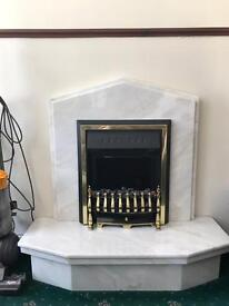 Marble fire place with electric fire