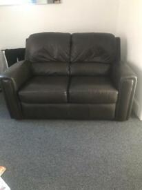 Brown leather two seater sofa and chair