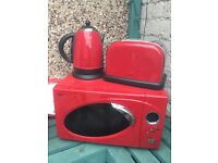Next Red microwave , kettle and toaster £40 with free plaque, dish drainer, clock and lap tray.