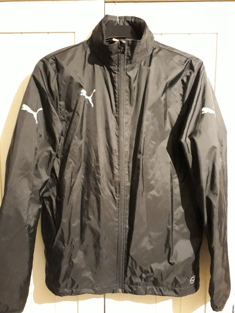 Puma waterproof jacket, black, youth 34/36. Excellent condition.