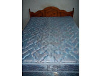 King size bed with wooden headboard