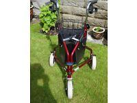 three wheeled mobility aid.