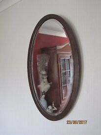 Oval bevelled wall mirror