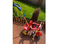 Child's push along bike. Handle may need attention to stay in place firmly