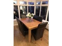 Dining table & six faux brown leather chairs