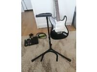 Electric guitar + multieffect guitar + bag + stand + cables + strings