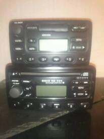 2 ford stereos 1 tape 1 cd good condition with codes