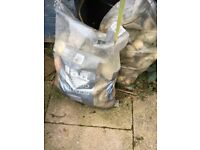Four bags of beach pebbles small and larger pebbles for sale pick up only east london