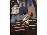 A large bundle of boys clothes