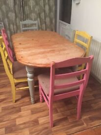 Wooden pine extendable dining table and six chairs For sale.