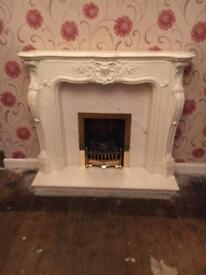 Marble , gas fire and surround