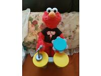 Elmo drumming and singing toy