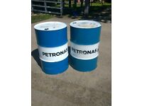 A pair of matching oil drums