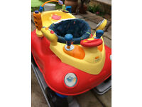Baby bouncer in the shape of a car