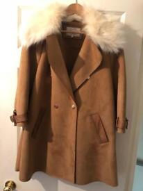 Tanned suede coat with fur hood