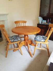 Round pine table with 3 matching chairs